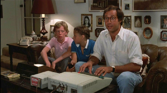 Chevy Chase plans the family vacation on his computer in National Lampoon's Vacation