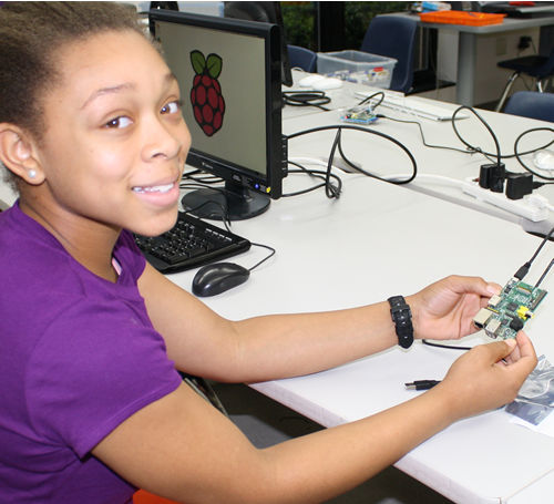 Young female engineer works on her $35 computer, the Raspberry Pi