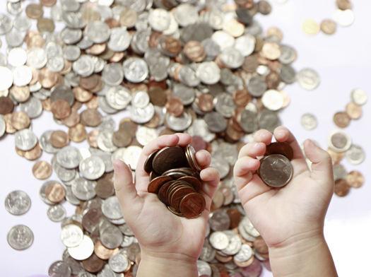 Coins in Hand by Claudio Jule